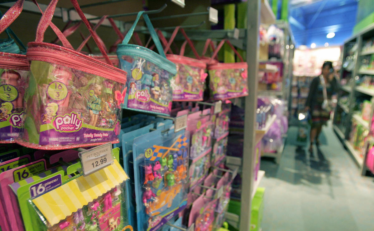 Polly Pocket toys hang on display in a M