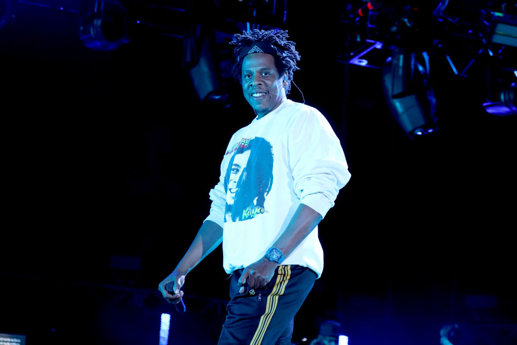 jay-z smiling while performing on stage