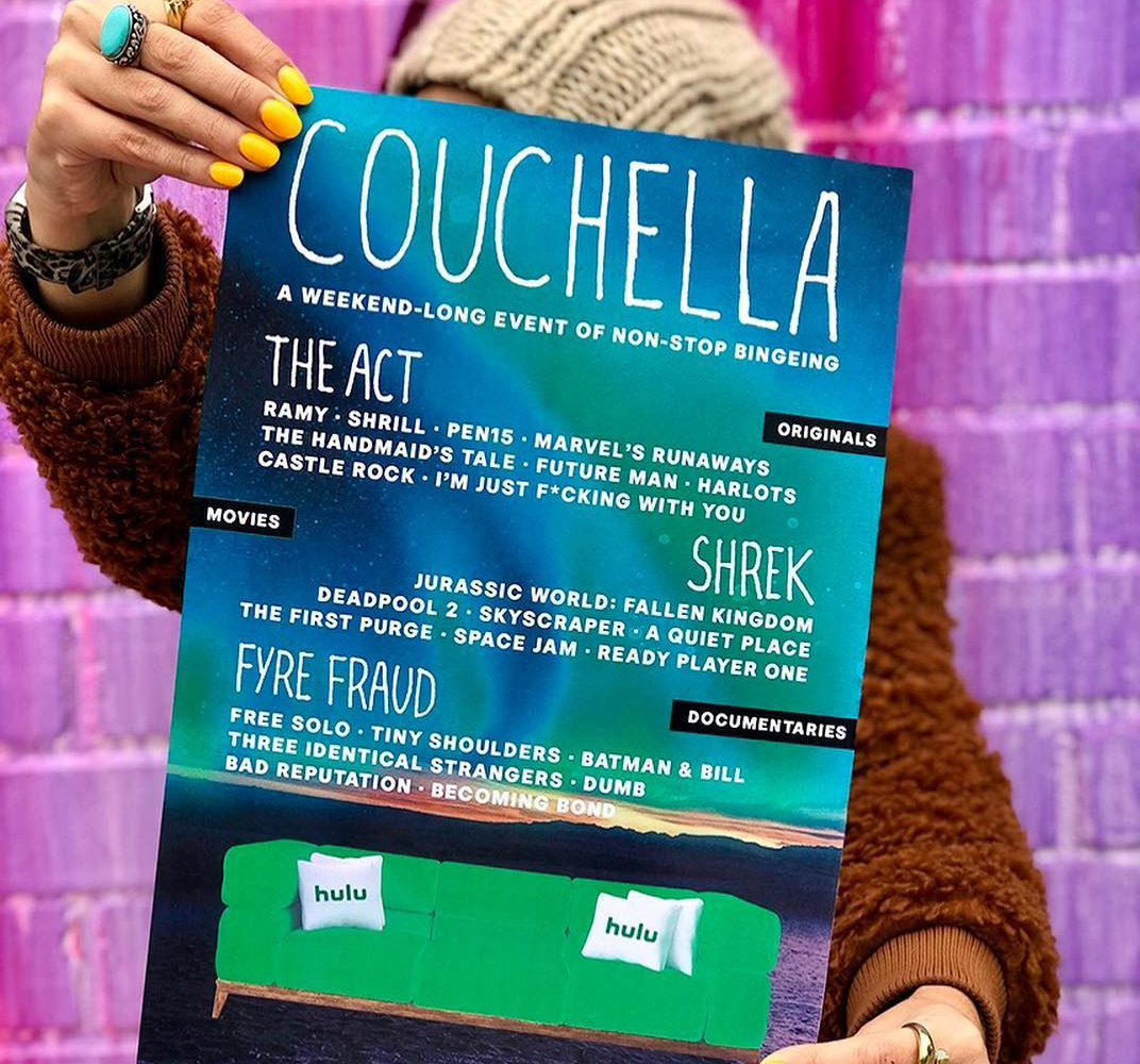 an ad for hulu of a woman holding up a couchella sign