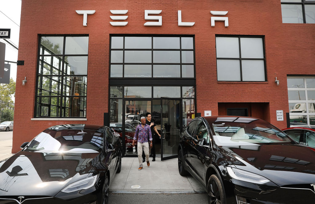 Tesla vehicles stand outside of a Brooklyn showroom and service center on August 27