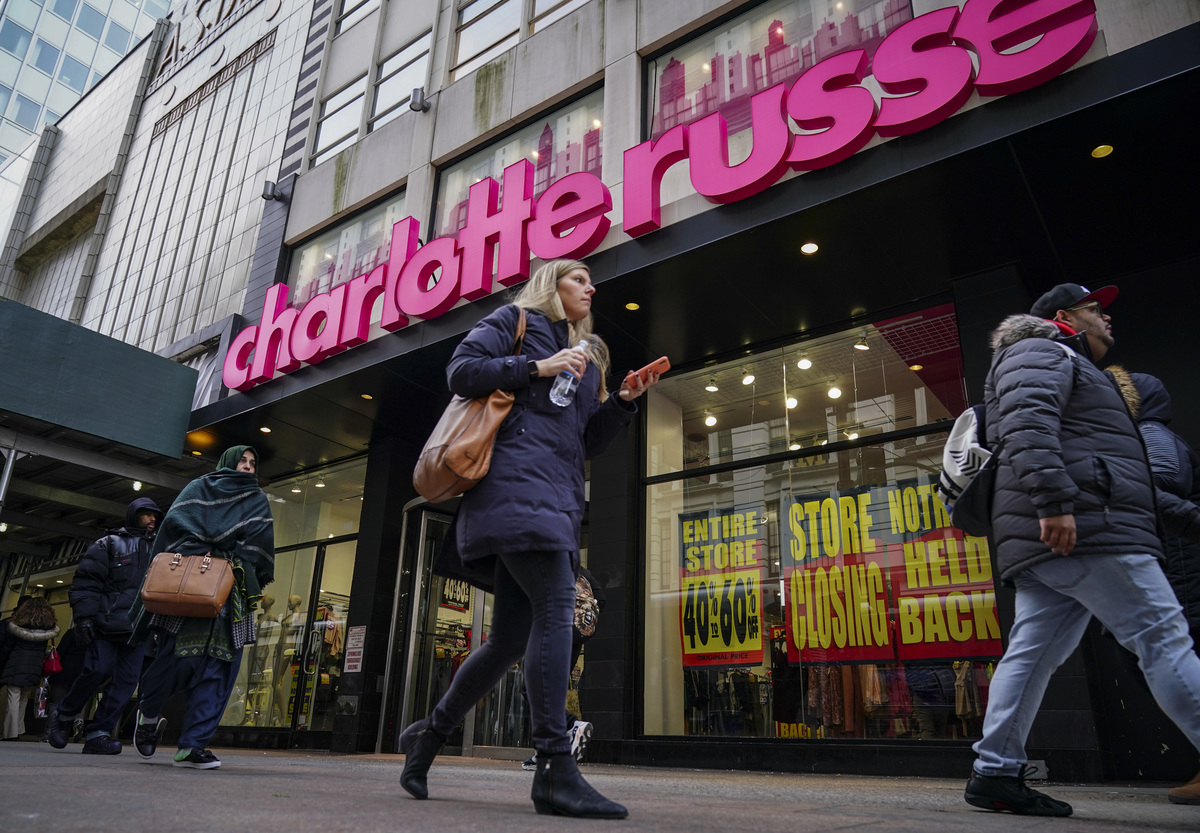 A Charlotte Russe store displays liquidation signs in the window near Herald Square in New York City.
