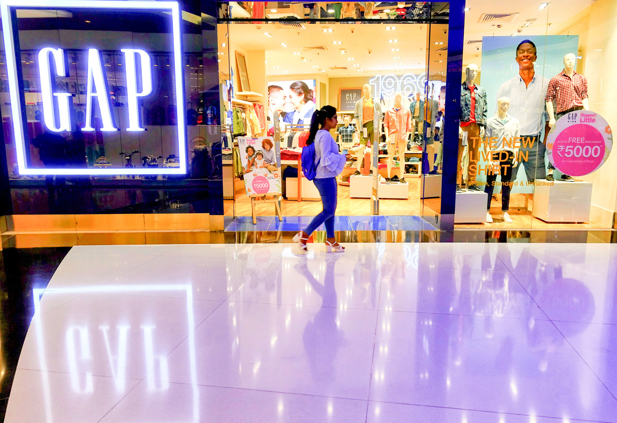 A young girl seen walking in front GAP branded garments store at the South City Mall
