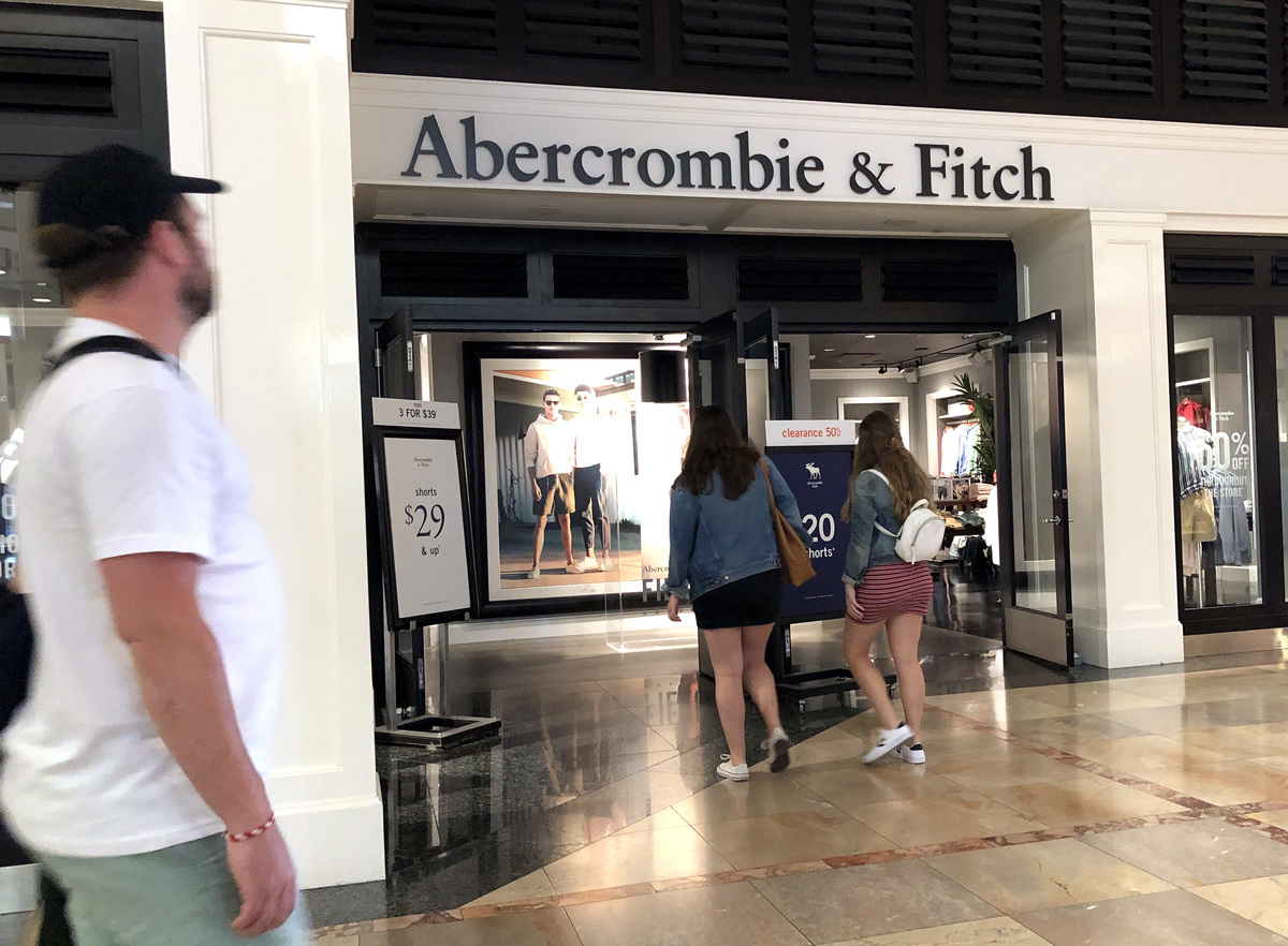 Customers enter an Abercrombie and Fitch store