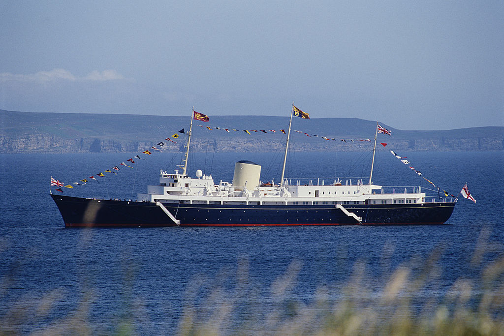 Britannia lies at anchor of the port of Scrabster as members of the Royal family disembark to visit the Queen