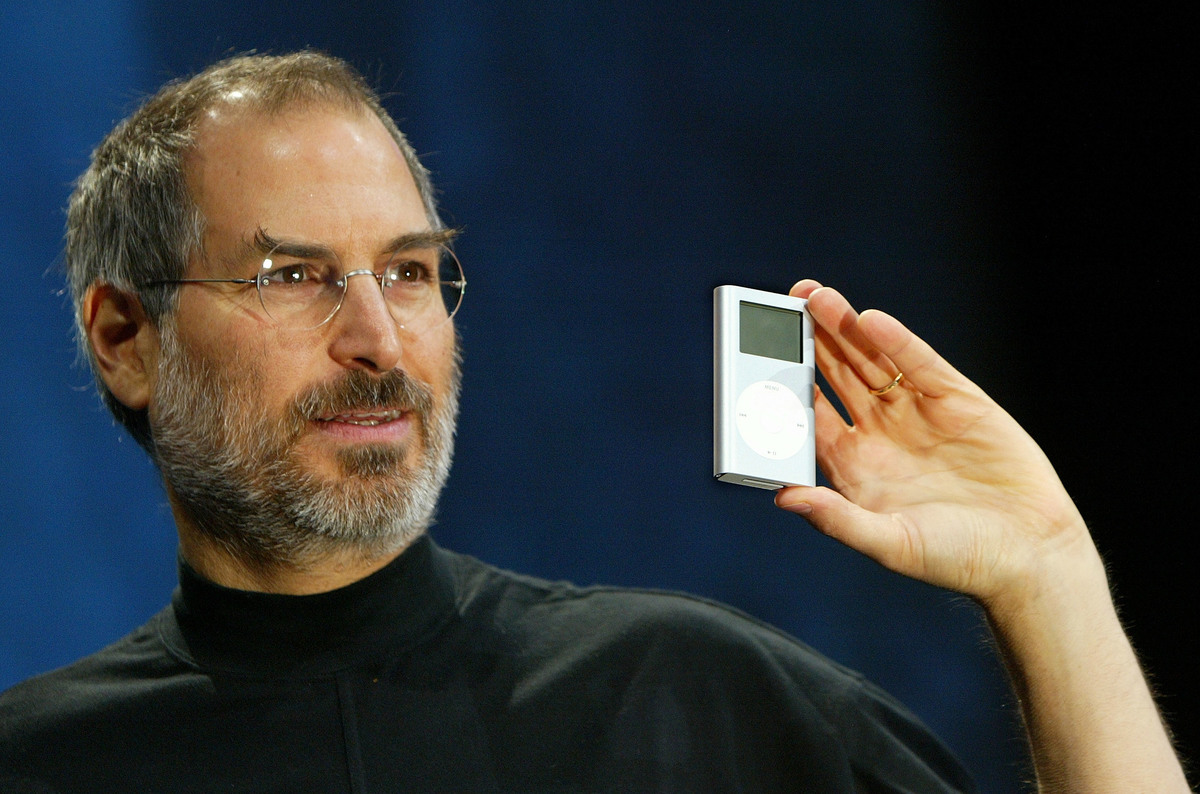 Apple CEO Steve Jobs holds a new mini iPod at Macworld January 6, 2004 in San Francisco.
