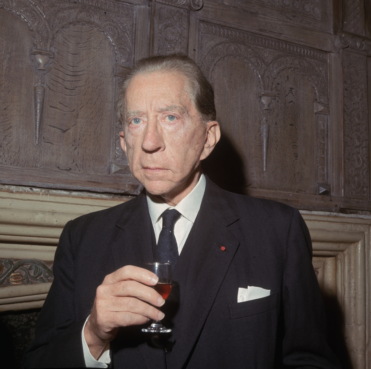Oil multi-millionaire and art collector, J. Paul Getty (1892 - 1976) with a glass of wine.