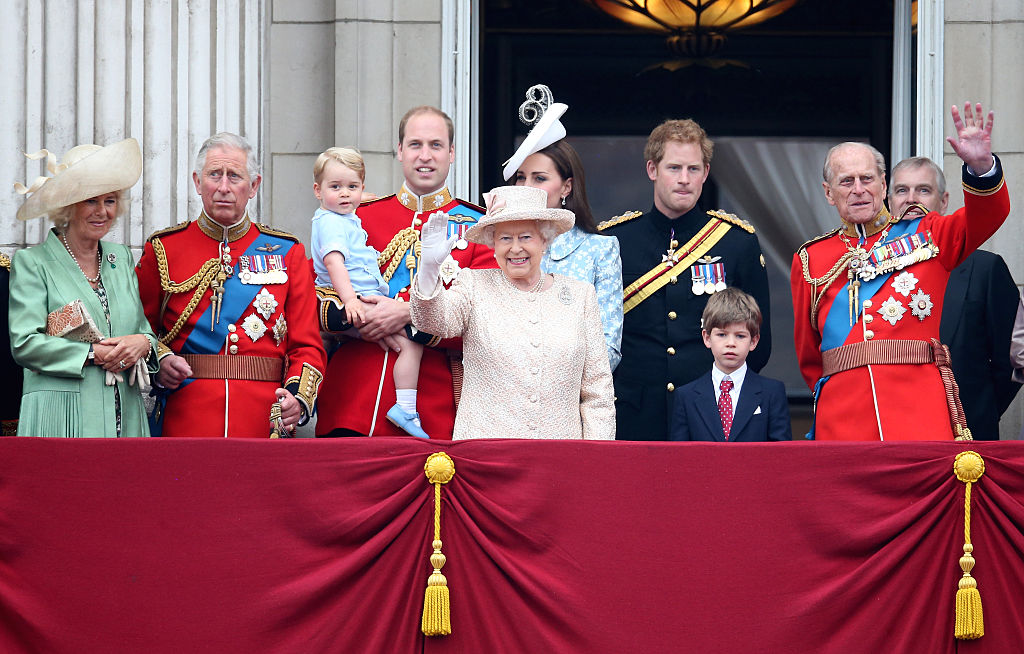 The British Royals standing on the balcony waving to the kind people