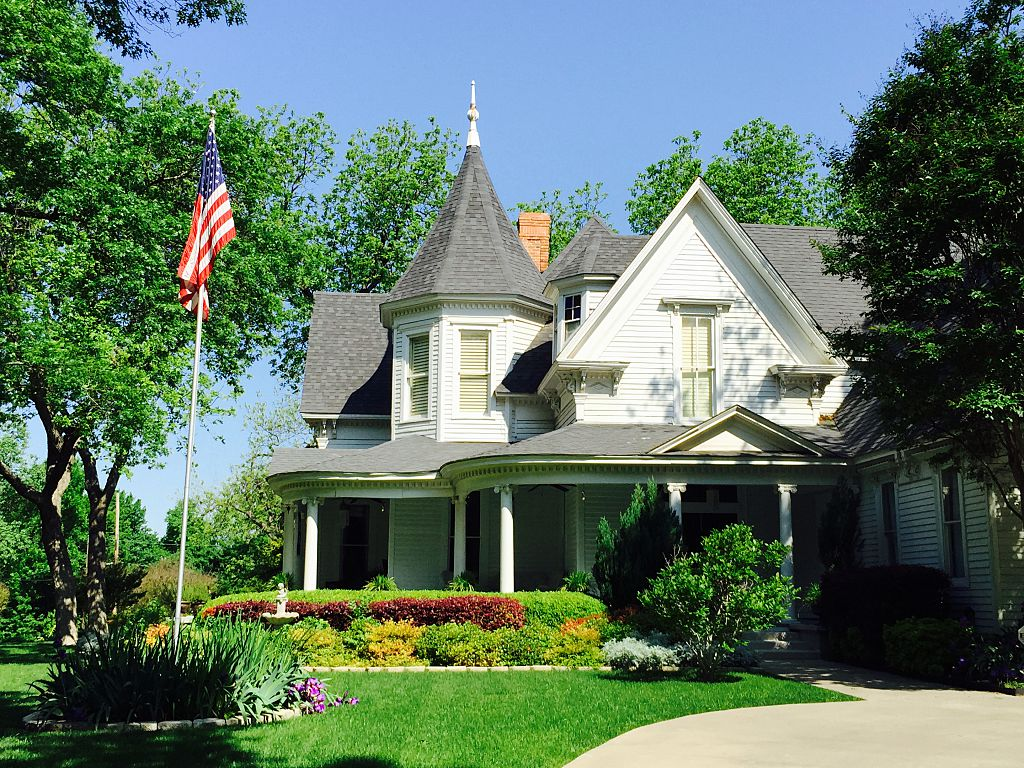 U.S. Flag on historic gingerbread house in Waxahachie Texas