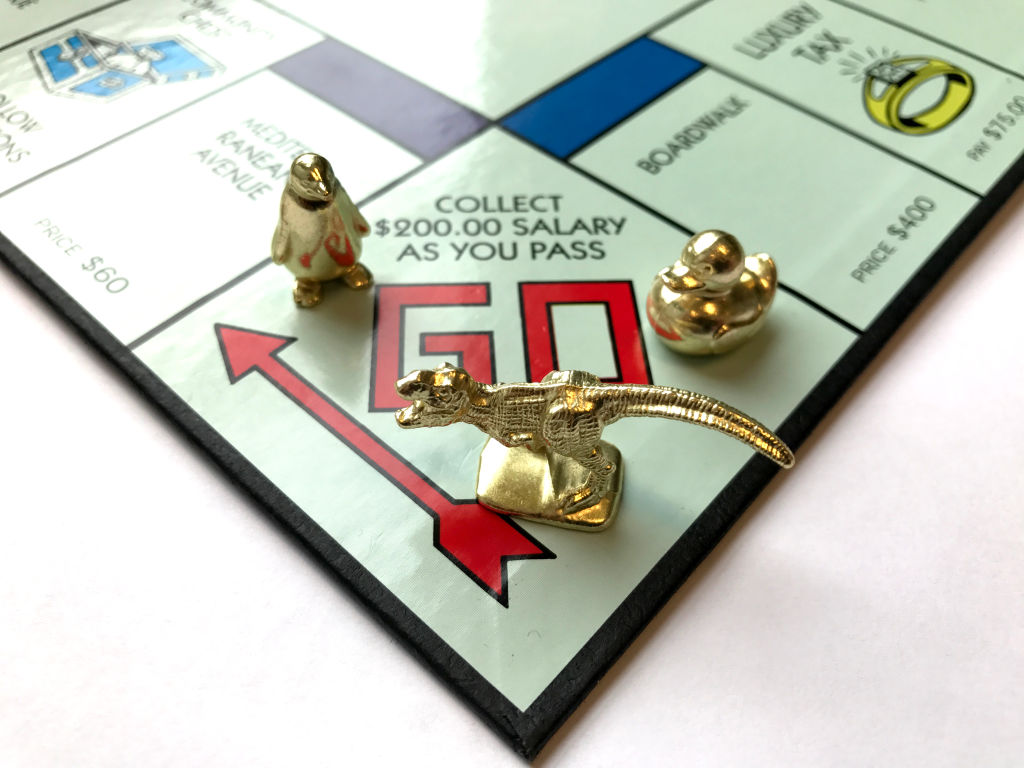 Monopoly with gold playing pieces