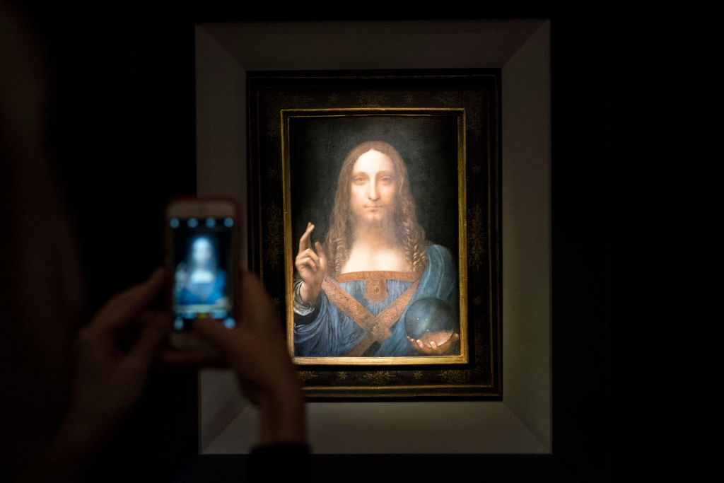 Salvator Mundi A visitor takes a photo of the painting 'Salvator Mundi' by Leonardo da Vinci
