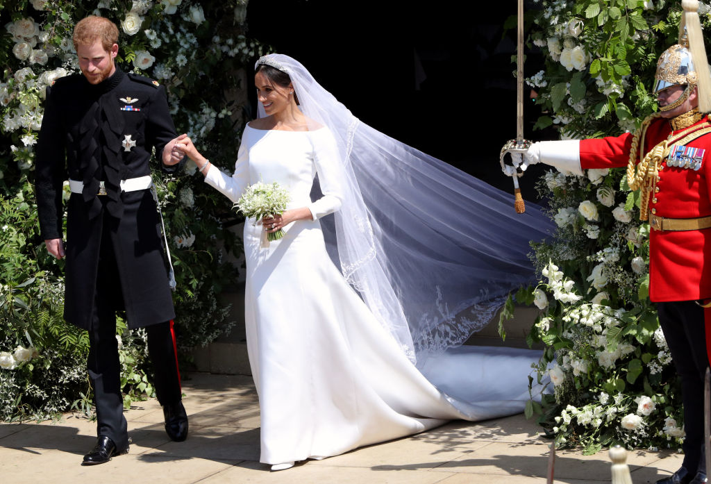 dress Duke of Sussex and his wife Meghan, Duchess of Sussex emerge from the West Door