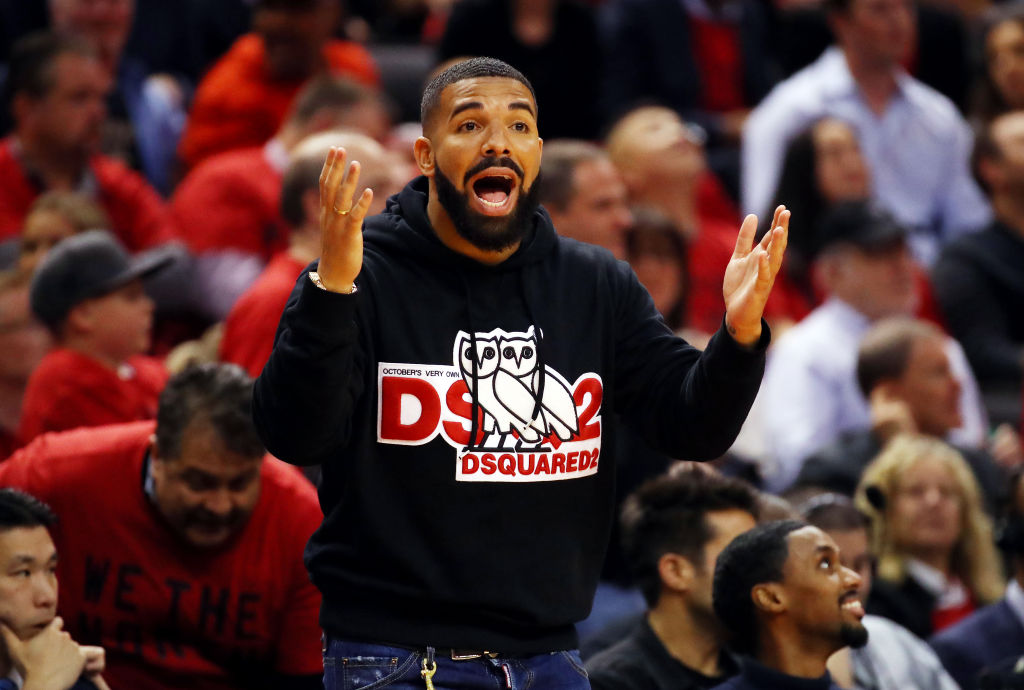 drake cheering on the players at an NBA game