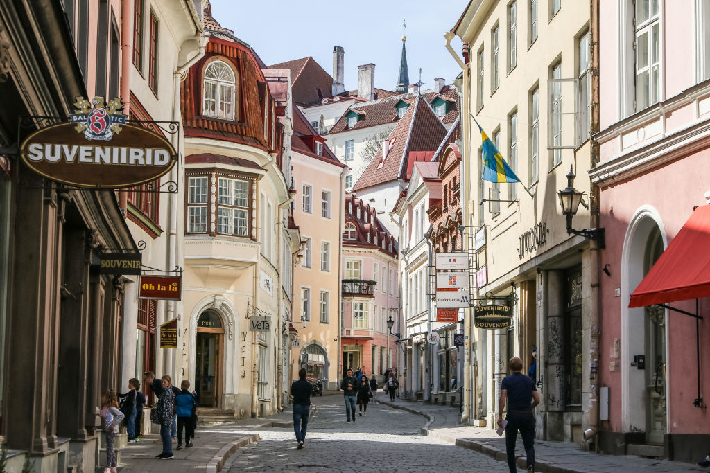 people walking in an old town street in estonia