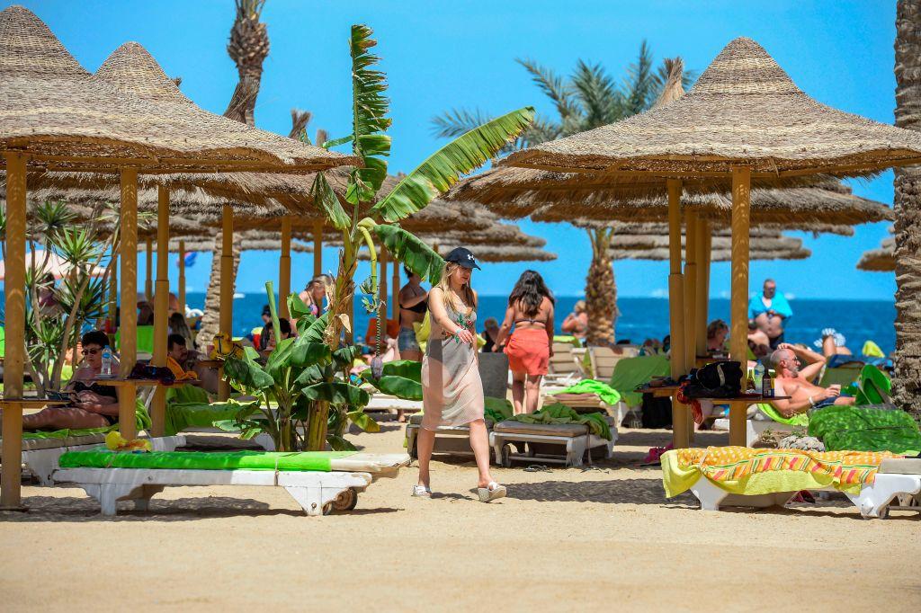 tourists sunbathing on a beach in hurghada, egypt