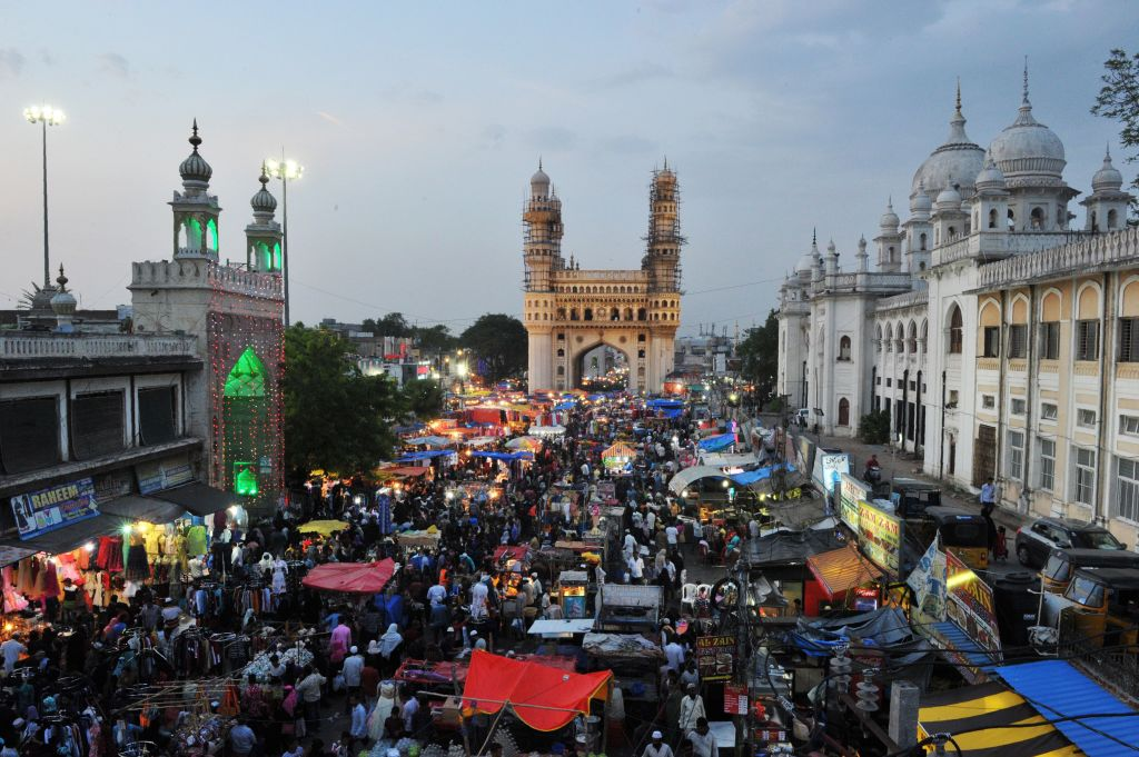 people gathered in front of the charminar at a festival