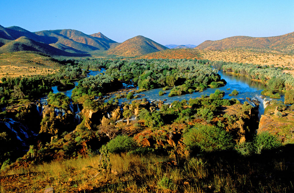 the mountains and a river running through namibia