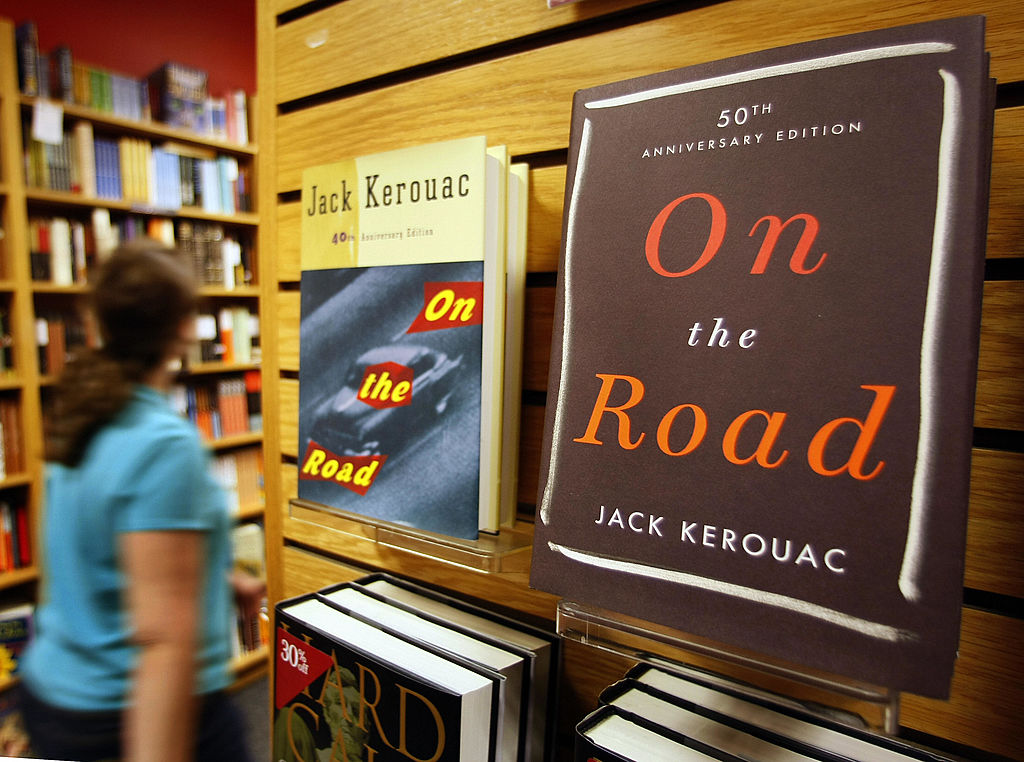 two copies of on the road displayed in a book store