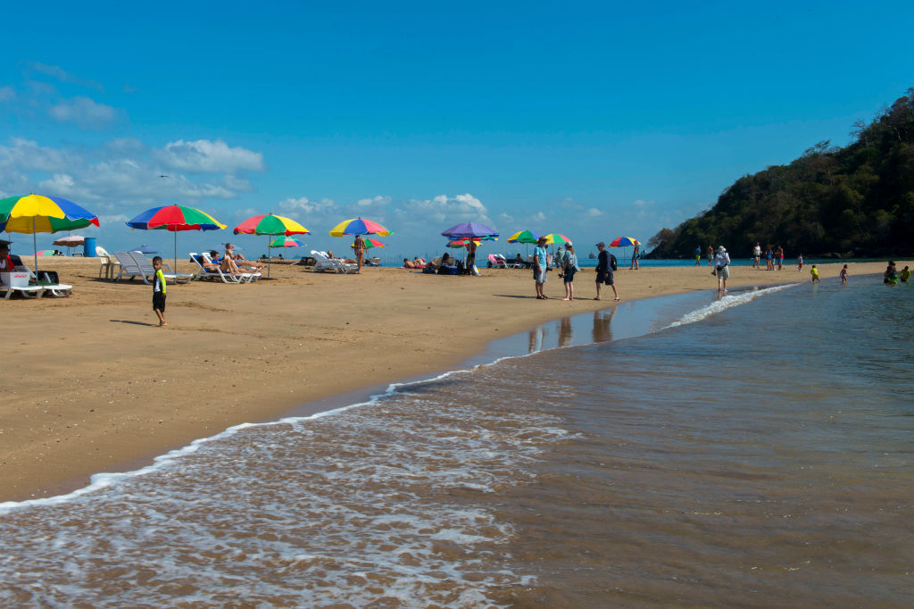 beach scene with colorful umbrellas