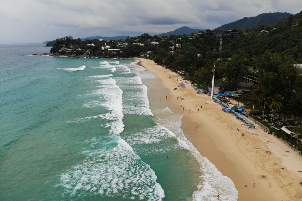 aerial of tourists on the kata noi beach in phuket, thailand