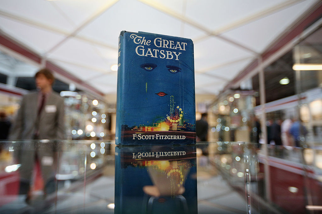 first edition of the great gatsby book displayed on a glass counter