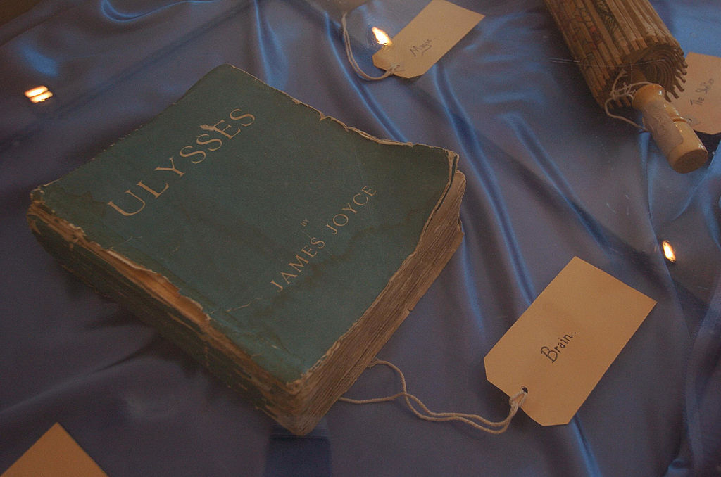 a worn down copy of ulysses on a tablecloth with a tag that says brain