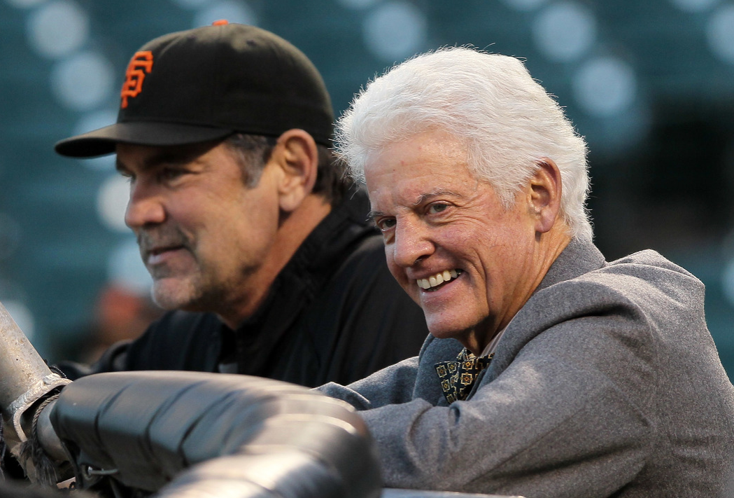 San Francisco Giants owner Bill Neukom (R) watches batting practice with manager Bruce Bochy
