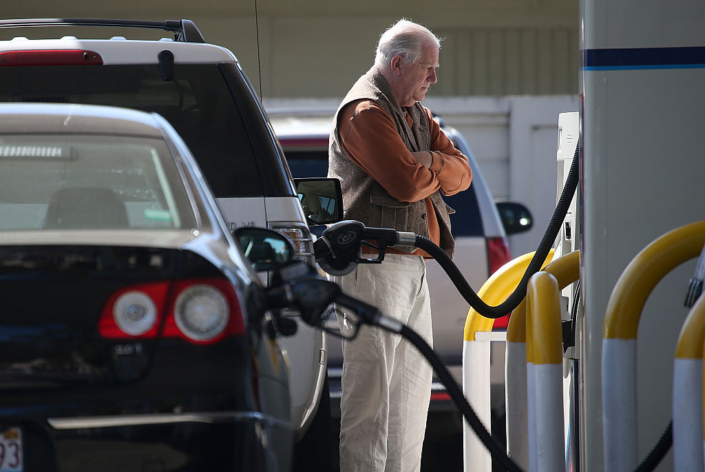 GettyImages-465175874 man filling gas