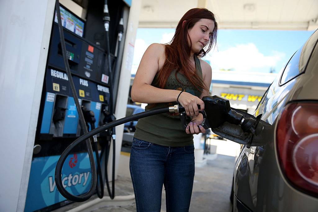 GettyImages-485934243 Gabrielle Smith pumps gas at the Victory gas station on April 21, 2014 in Pembroke Pines, Florida.