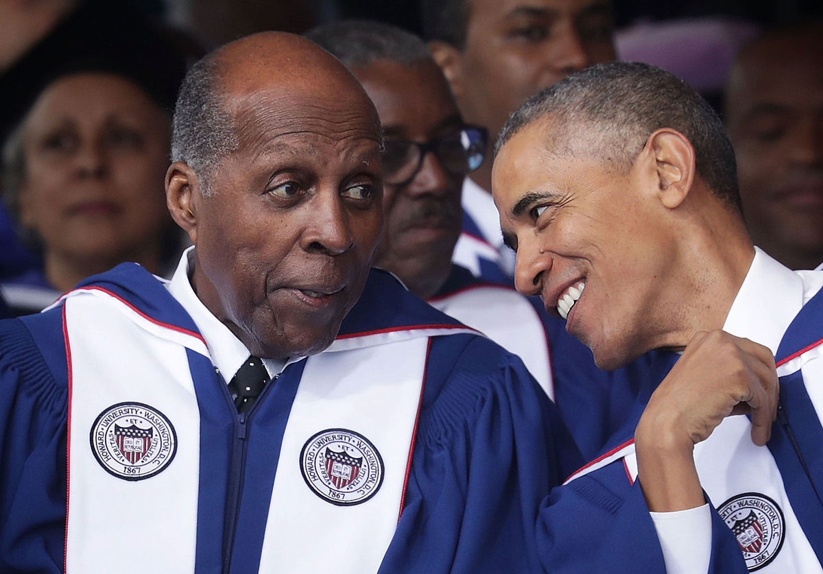 President Barack Obama (R) with member of Howard University Board of Trustees Vernon Jordan (L) during the 2016 commencement ceremony at Howard University