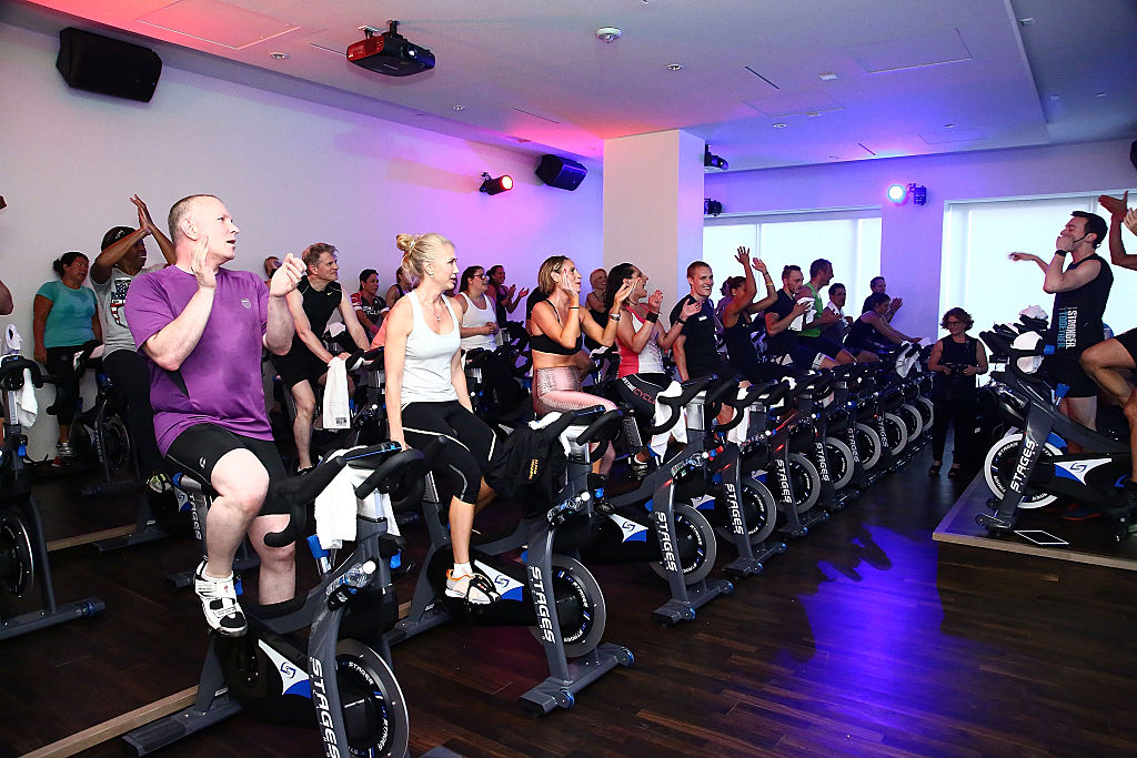 Guests are seen during a spin class using Stages Cycling bicycles at Life Time Athletic At Sky during its Grand Opening on June 1, 2016 in New York City-537492064