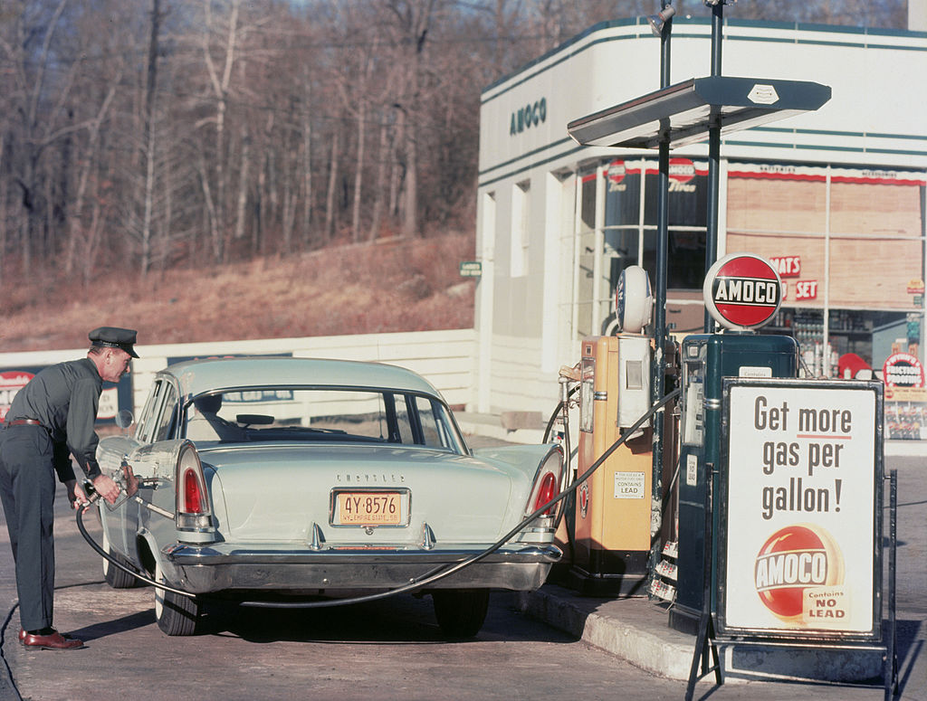 GettyImages-73467112 A petrol pump attendant filling up a Chrysler car at an Amoco station, 1958.