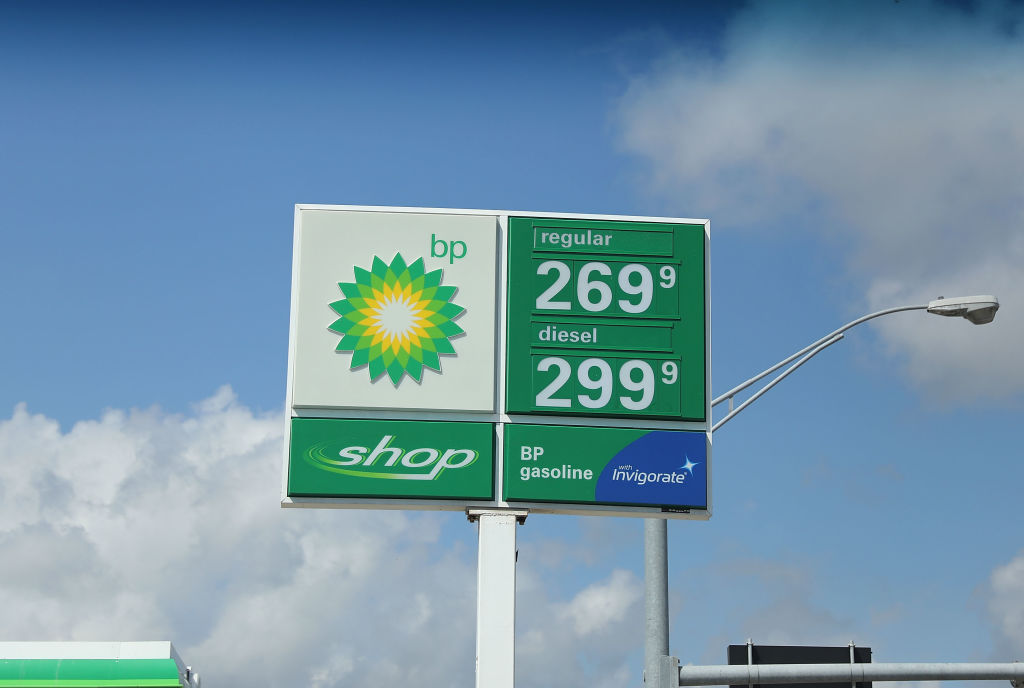 GettyImages-943812902 A sign displaying the price of gasoline per gallon is seen at a BP gas station