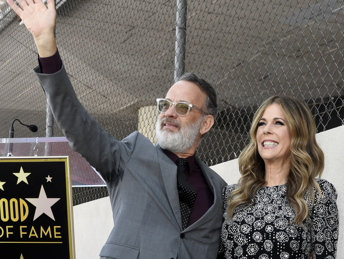 Tom Hanks and Rita Wilson stand next to Wilson's star as she is honored on the Hollywood Walk of Fame, 2019