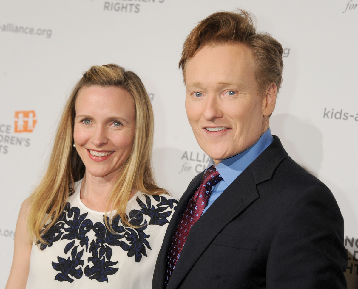 TV personality Conan O'Brien (R) and wife Liza Powel arrive at The Alliance for Children's Rights, 2013