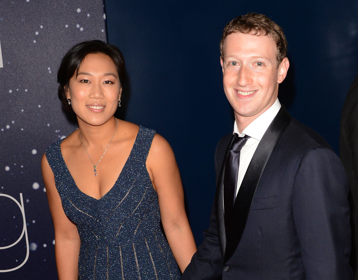 Mark Zuckerberg and his wife, Priscilla Chan, attend the 2014 Breakthrough Prize Awards at NASA