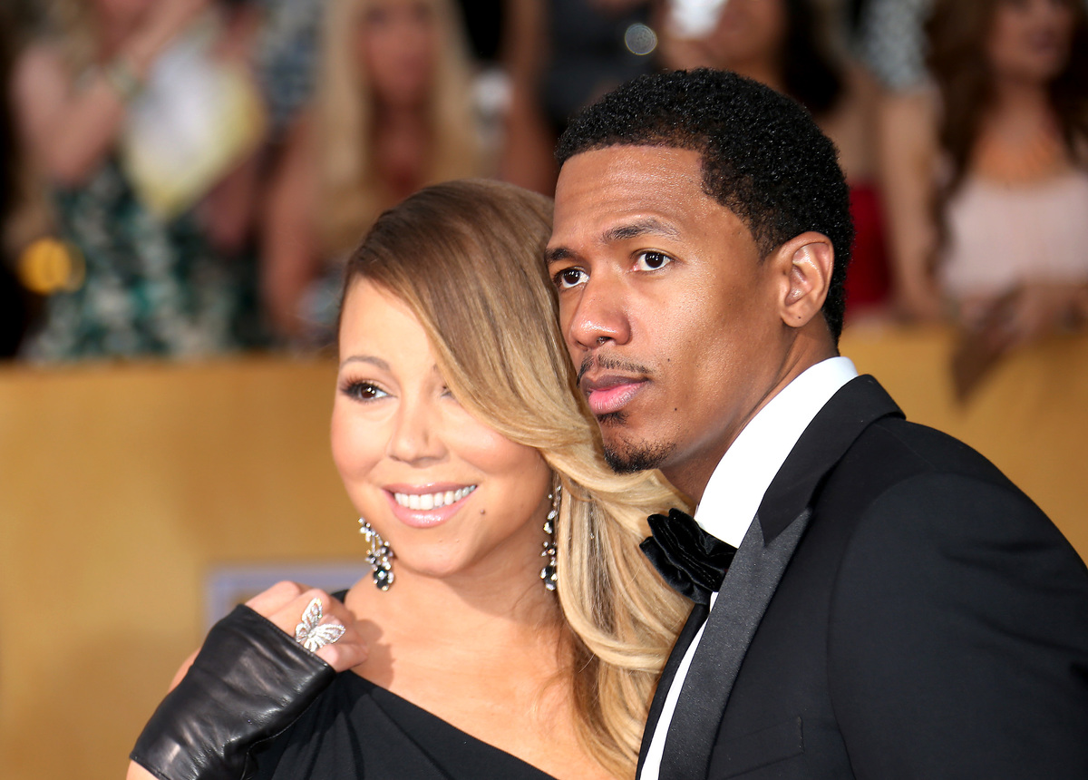 Mariah Carey and Nick Cannon (R) arrive at the 20th Annual Screen Actors Guild Awards, 2014