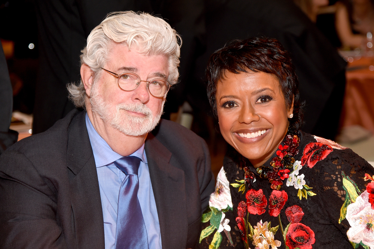 Mellody Hobson and film director George Lucas pose for a photo at the