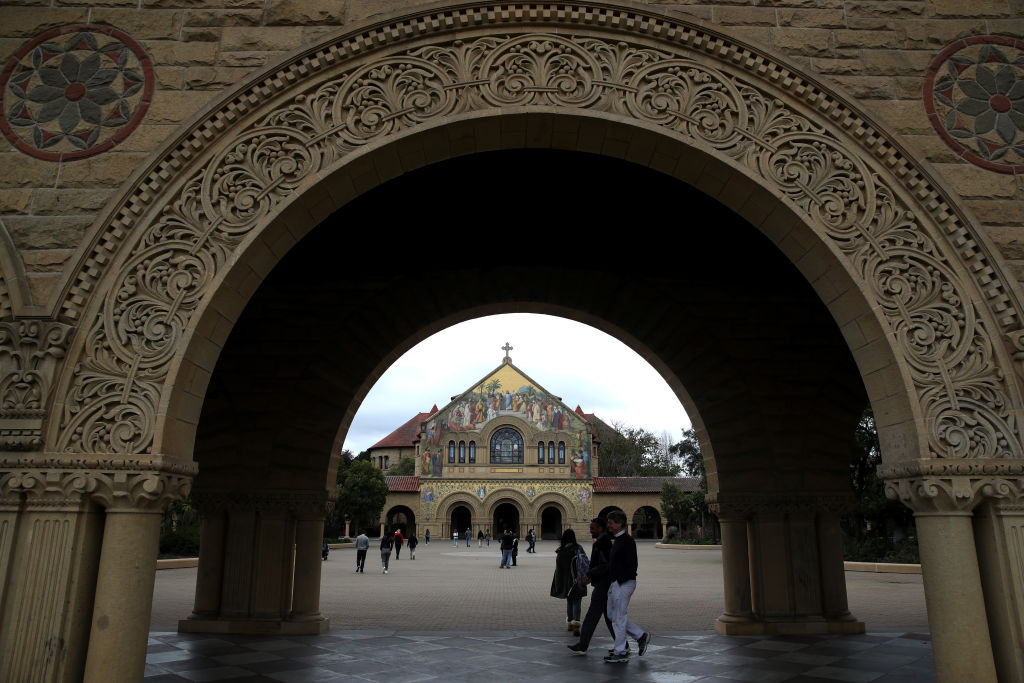 Students and visitors walk on the Stanford University campus