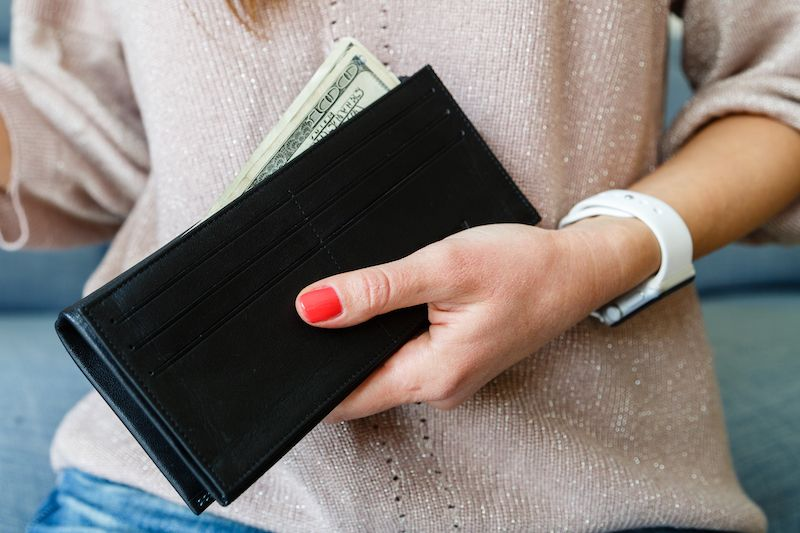 a woman holding a wallet