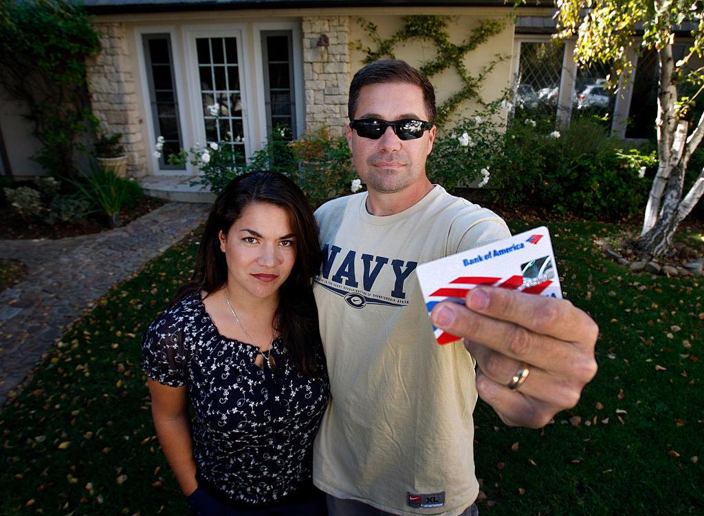 couple displaying credit card