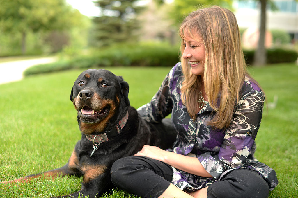 woman with her rottweiler