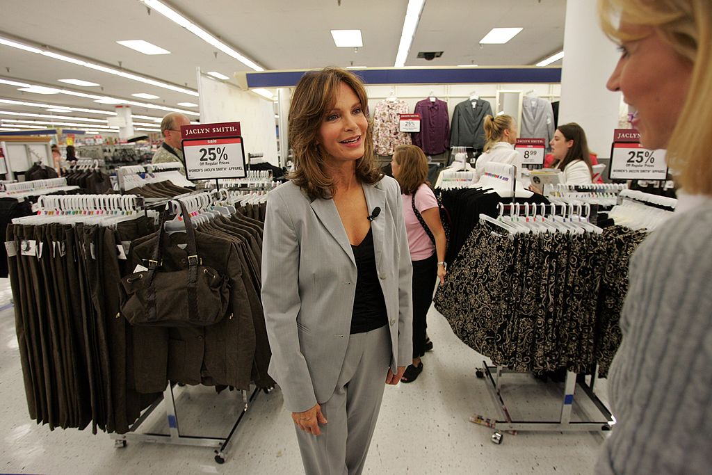Jaclyn Smith smiles while being interviewed in a Kmart near her clothing line
