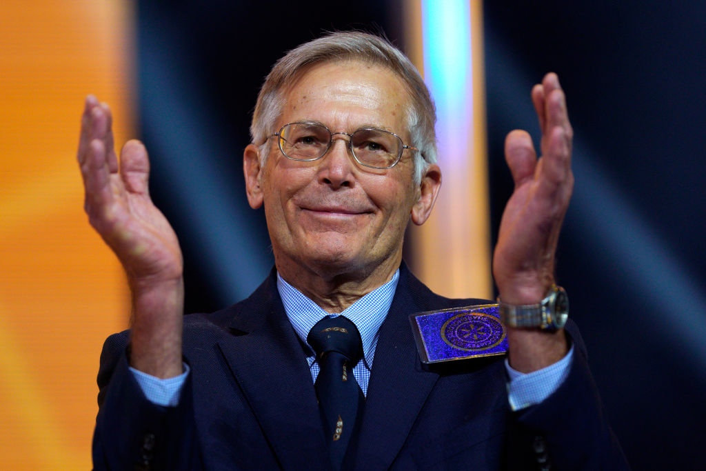 Jim Walton claps at the Walmart shareholders meeting event