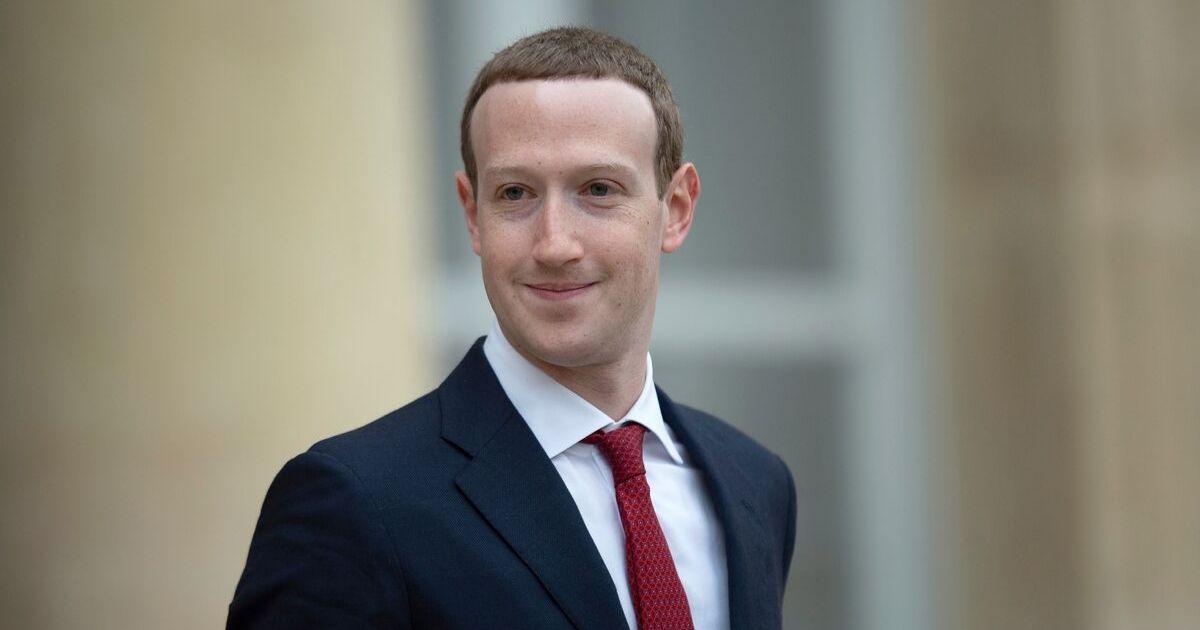 Facebook CEO Mark Zuckerberg smiling in s suit
