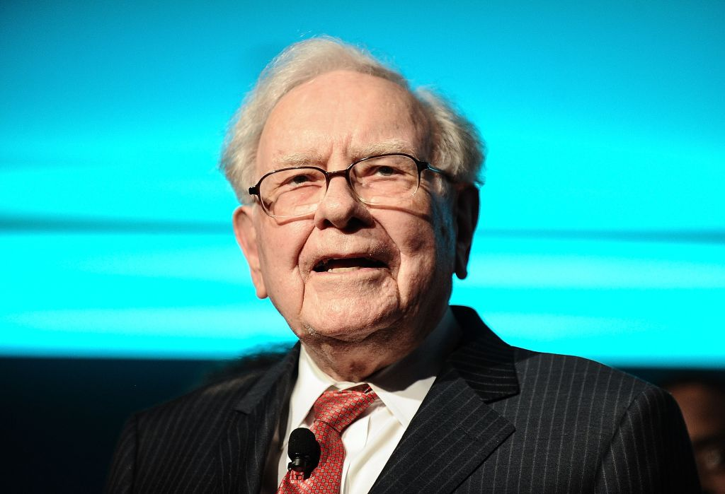 Philanthropist Warren Buffett is joined onstage by 24 other philanthropist and influential business people