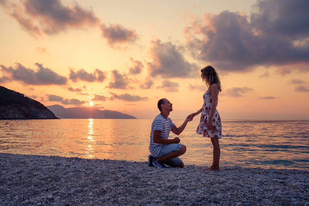 Romantic marriage proposal on the beach at the seaside