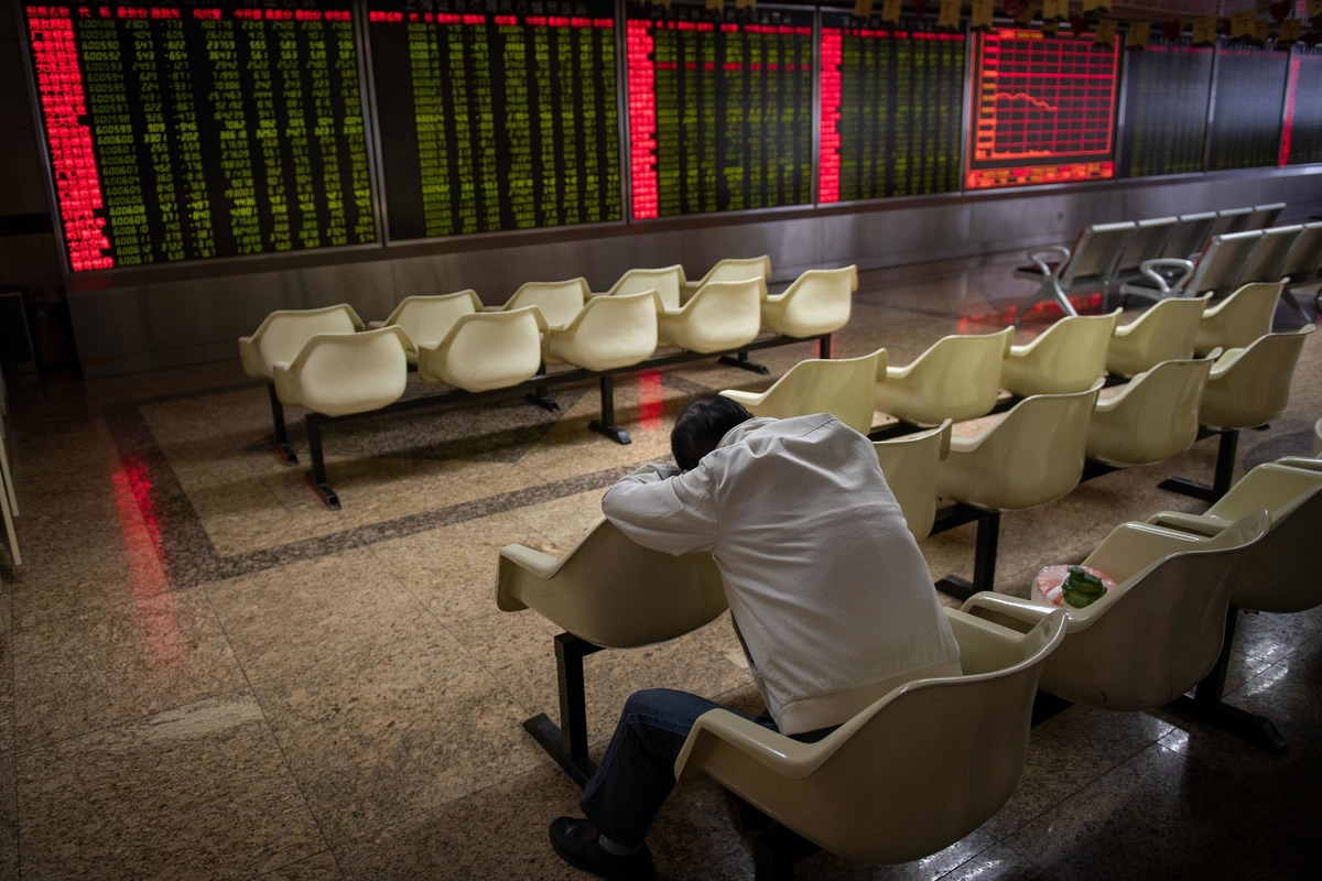 a man rests at the stock market