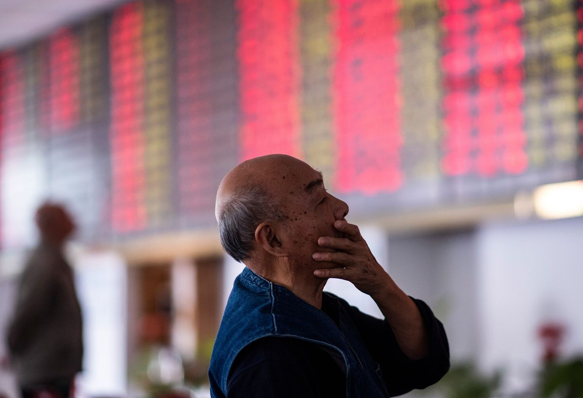 a man checks the market reports