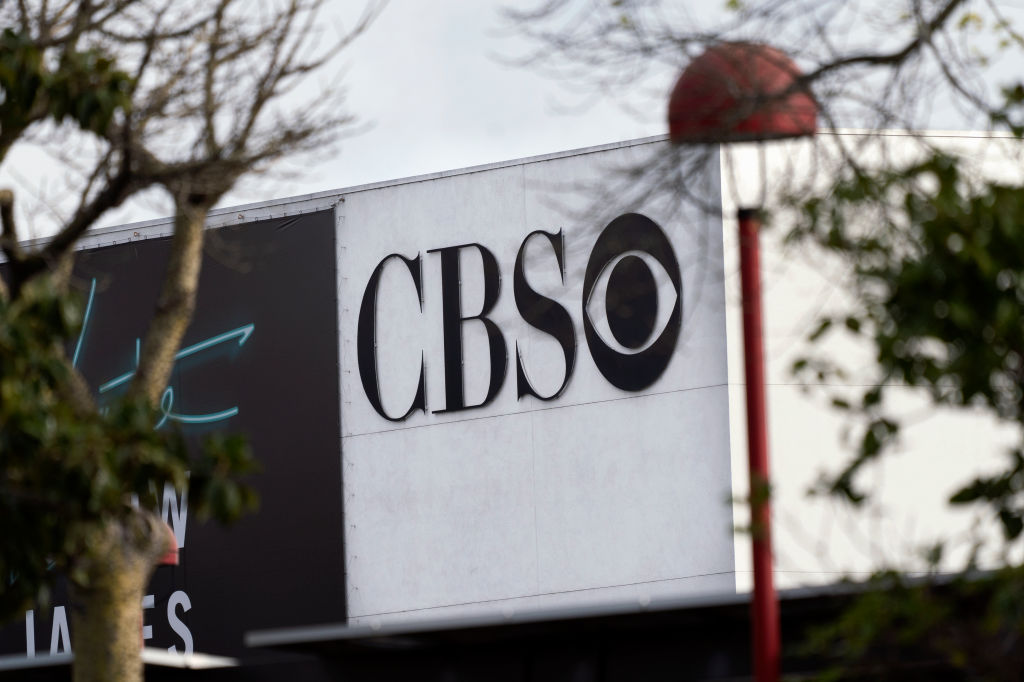 A photo shows the CBS logo on a building.