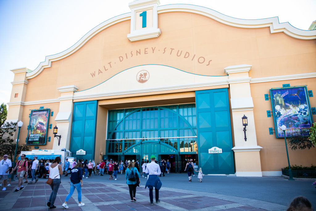 People enter the Walt Disney studios building.